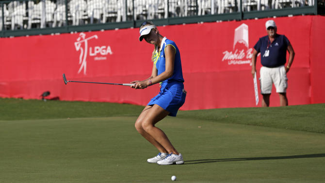 Jessica Korda reacts as her birdie putt on the 18th green lips out during second round play in the Mobile Bay LPGA Classic golf tournament at the Robert Trent Jones Golf Trail at Magnolia Grove in Mobile, Ala. Friday, May 17, 2013. (AP Photo/Dave Martin)