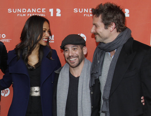 "Actress Zoe Saldana, left, co-writer and co-director Lee Sternthal, center, and actor Bradley Cooper pose at the premiere of ""The Words"" during the 2012 Sundance Film Festival in Park City, Utah on Friday, Jan. 27, 2012. (AP Photo/Danny Moloshok)"