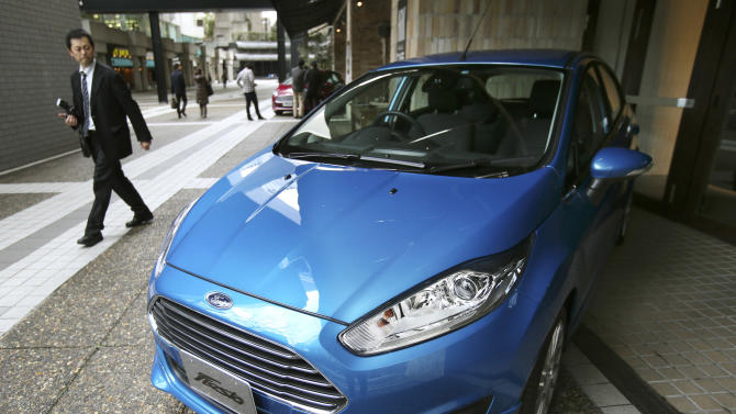 A man looks at a Ford Fiesta compact car in Tokyo Thursday, Jan. 9, 2014. Ford's Fiesta compact is back in Japan despite failing a decade ago in a market dominated by Toyota and other powerful local brands that specialize in small cars. (AP Photo/Koji Sasahara)