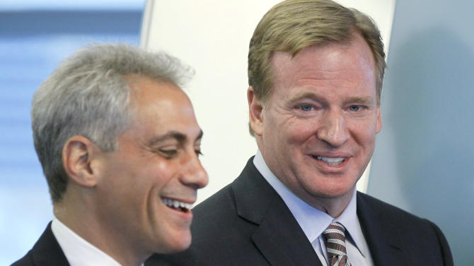 NFL Commissioner Roger Goodell, right, shares a laugh with Chicago Mayor Rahm Emanuel as they recongize Soldier Field as the only NFL stadium to become a LEED-certified green building during a news conference, Thursday, May 31 2012, in Chicago. (AP Photo/Charles Rex Arbogast)
