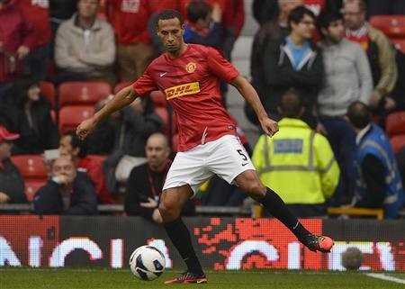 Manchester United's Ferdinand warms up ahead of their English Premier League soccer match against Stoke City in Manchester