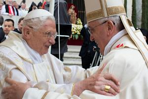 Pope Francis (right) greets Pope emeritus Benedict …