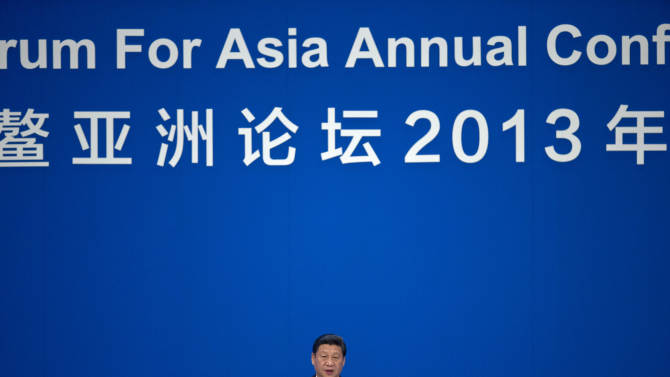 China's President Xi Jinping speaks at the opening ceremony of the annual Boao Forum in Boao, in southern China's Hainan province, Sunday, April 7, 2013. (AP Photo/Alexander F. Yuan, Pool)
