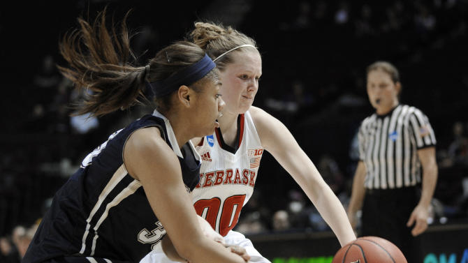 Chattanooga's Tatianna Jackson, left, knocks the ball away from Nebraska's Lindsey Moore during a first-round game in the NCAA women's college basketball tournament in College Station, Texas, Saturday, March 23, 2013. Nebraska won 73-59 and will play Texas A&M in the second round Monday. (AP Photo/Pat Sullivan)