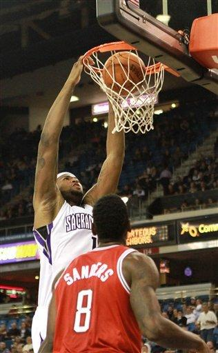Kings rally past Bucks to give Smart win in debut