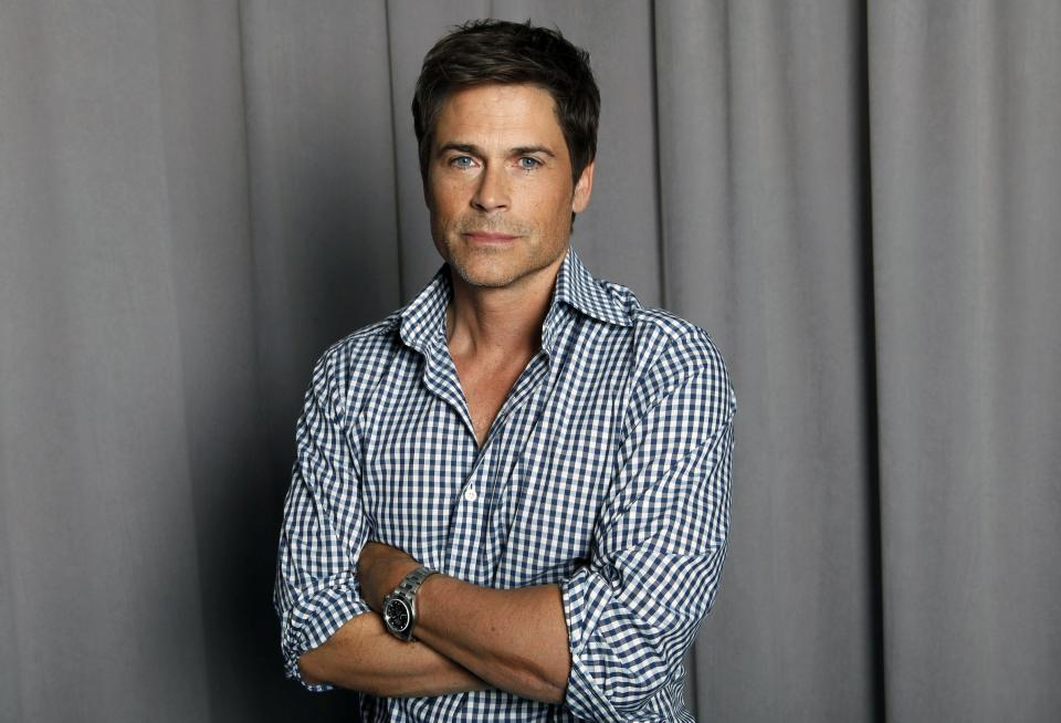 "FILE - This April 25, 2012 file photo shows actor Rob Lowe posing for a portrait in New York. Lowe will narrate ""The '80s: The Decade That Made Us,"" a six-part documentary series that begins airing Sunday on National Geographic Channel.  (AP Photo/Amy Sussman, file)"