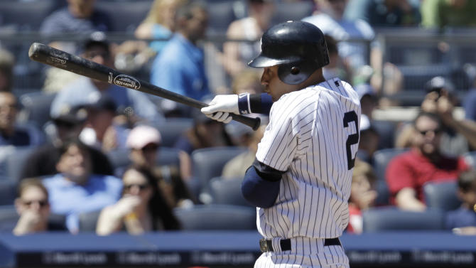 New York Yankees' Derek Jeter (2) backs away from an inside pitch during the third inning of an interleague baseball game against the Cincinnati Reds at Yankee Stadium in New York, Sunday, May 20, 2012. (AP Photo/Kathy Willens)