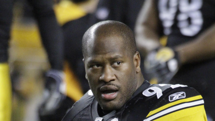 """FILE - Pittsburgh Steelers linebacker James Harrison (92) warms up before an NFL football game against the Carolina Panthers in Pittsburgh, in this Dec. 23, 2010 file photo. Heavily fined Pittsburgh Steelers linebacker James Harrison calls NFL Commissioner Roger Goodell a """"crook"""" and a """"devil,"""" among other insults, in a magazine article in the August issue of Men's Journal. (AP Photo/Gene J. Puskar, File)"""