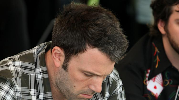 Ben Affleck plays poker at Playing For Good Benefitting the Geffen Playhouse and Determined to Succeed on Saturday May 12, 2012 in Santa Monica, Calif. (Casey Rodgers/AP Images for Geffen Playhouse)
