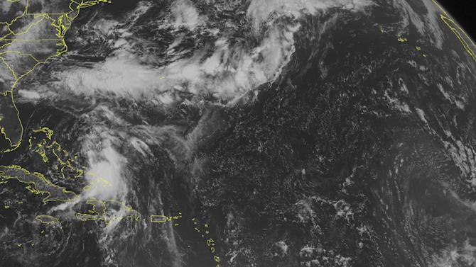 This NOAA satellite image taken Sunday, Aug. 24, 2014 at 10:45 AM EDT shows Tropical Storm Cristobal moving northward across the Bahamas, as a dense area of clouds with heavy rain and gusty winds. A band 0f clouds present across Bermuda to the Southeast US is associated with a frontal boundary. More scattered clouds are present across Hispaniola and eastern Cuba into the eastern Caribbean Basin. (AP PHOTO/WEATHER UNDERGROUND)