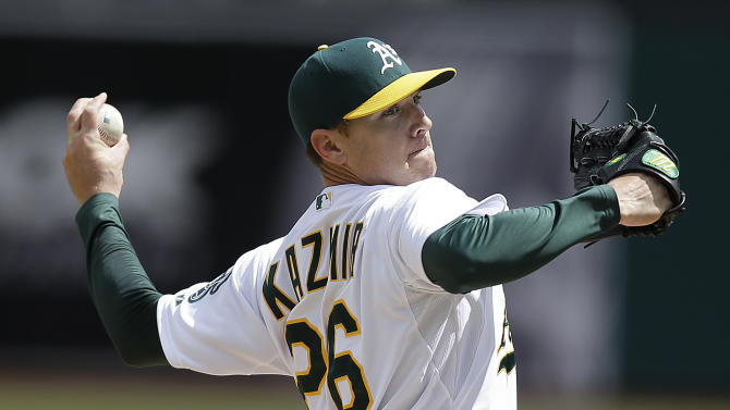 Indians rally to split doubleheader with A's
