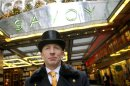 Doorman at the Savoy Hotel for the past twenty eight years, Peter Maglin, stands on duty in central London, ahead of an auction