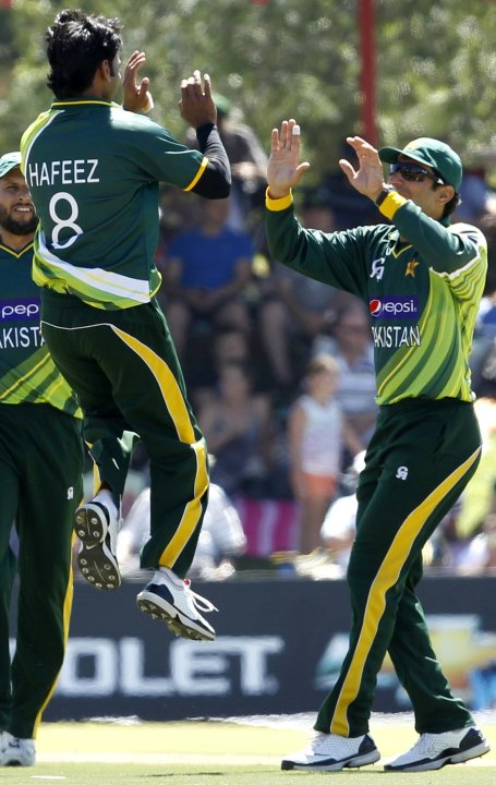 "Pakistan""s Shoaib Malik is congratulated by Mohammad Hafeez after Malik caught out South Africa's Hashim Amla during their One day International cricket match in Bloemfontein"