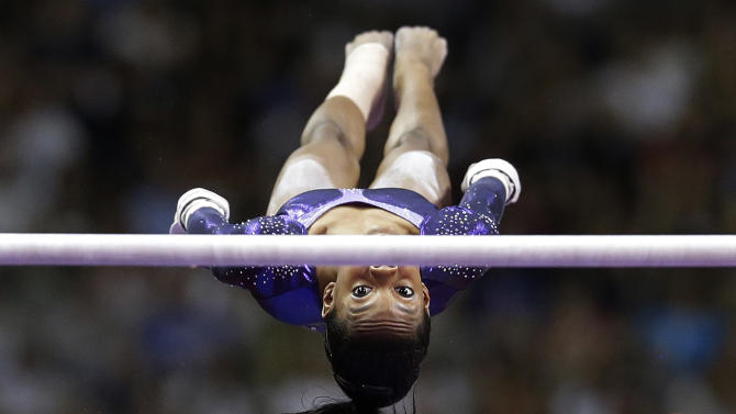 Gabby Douglas competes on the uneven bars during the final round of the women's Olympic gymnastics trials, Sunday, July 1, 2012, in San Jose, Calif. (AP Photo/Jae C. Hong)