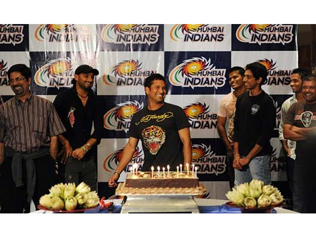 Sachin Tendulkar at a surprise birthday party in Durban early April 24, 2009. Also seen in the picture are Harbhajan Singh and Kris Srikkanth. (SAEED KHAN/AFP/Getty Images)