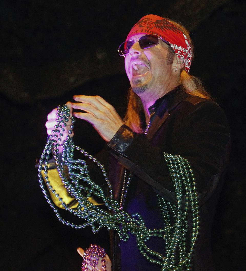 Entertainer Bret Michaels holds a handful of beads while riding in the Mardi Gras parade in New Orleans, Monday, Feb. 20, 2012.  (AP Photo/Bill Haber)