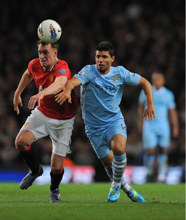 Manchester United's English Defender Phil Jones (L) Vies For The Ball Against Manchester City's Argentinian Footballer AFP/Getty Images