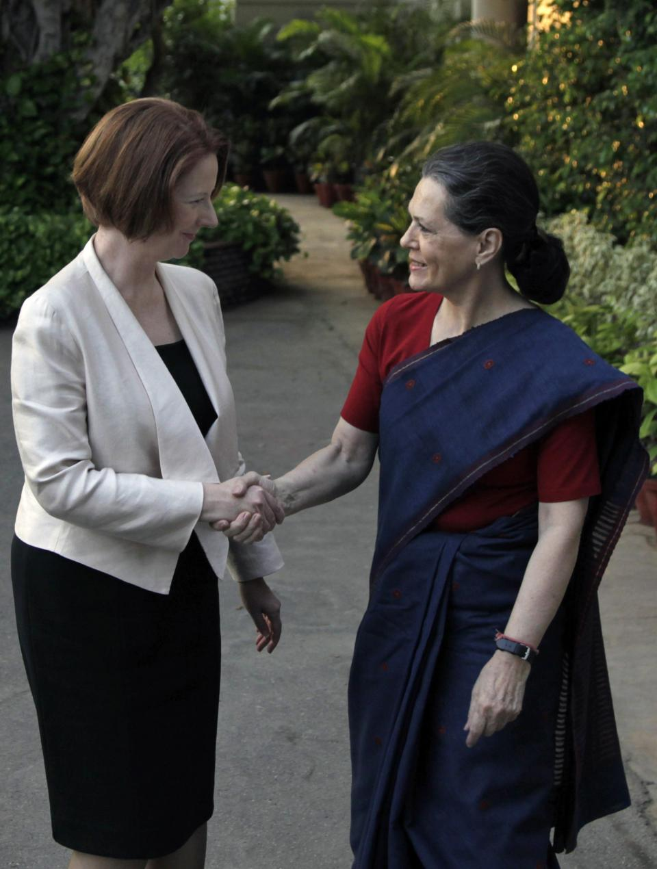 Australian Prime Minister Julia Gillard, left, shakes hands with India's Congress Party president Sonia Gandhi, at the latter's residence before a meeting in New Delhi, India, Wednesday, Oct. 17, 2012. India and Australia began talks Wednesday to strengthen economic and strategic ties and explore cooperation in civilian nuclear energy. (AP Photo/ Mustafa Quraishi)