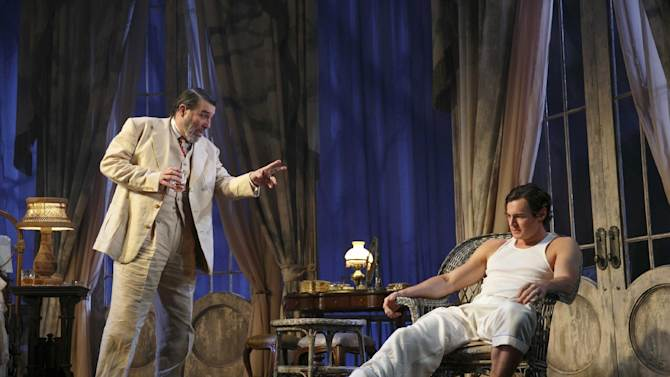 "This undated theater image released by Boneau/Bryan-Brown shows Ciaran Hinds, left, and Benjamin Walker during a performance of ""Cat on a Hot Tin Roof,"" playing at the Richard Rodgers Theatre in New York. (AP Photo/Boneau/Bryan-Brown, Joan Marcus)"
