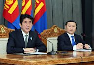 Japanese Prime Minister Shinzo Abe (L) and his Mongolian counterpart Altankhuyag Norov hold a joint press conference in Ulan Bator on March 30, 2013. Abe sought support from Mongolia on Saturday in Tokyo's territorial row with Beijing over disputed East China Sea islands, during a visit to the country