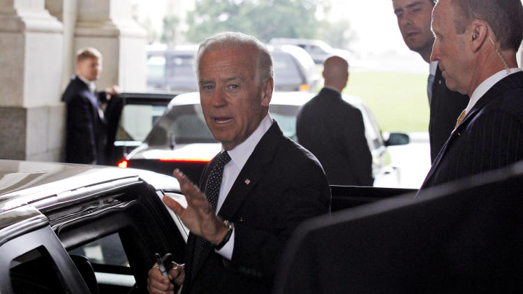 Vice President Joe Biden gets in the car to leave after a meeting about debt reduction on Capitol Hill Tuesday, June 14, 2011 in Washington.(AP Photo/Alex Brandon)