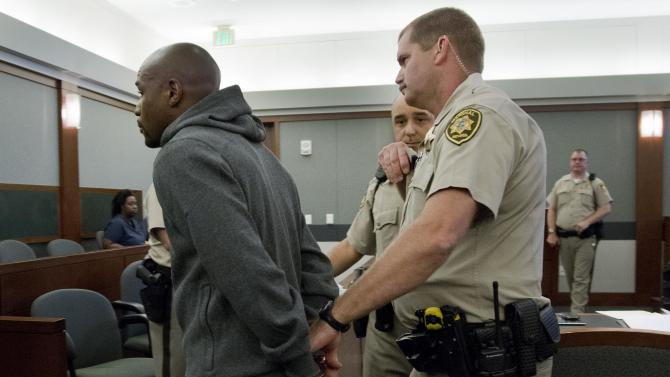 Floyd Mayweather Jr., left, is led away by court marshall Ron Johnson, Friday, June 1, 2012, in Las Vegas, to begin a 90-day jail term for attacking his ex-girlfriend in September 2010 while two of their children watched. The undefeated five-division champion surrendered Friday before the judge who sentenced him in Decemberr, and then allowed him to remain free long enough to headline a May 5 fight. (AP Photo/Julie Jacobson)