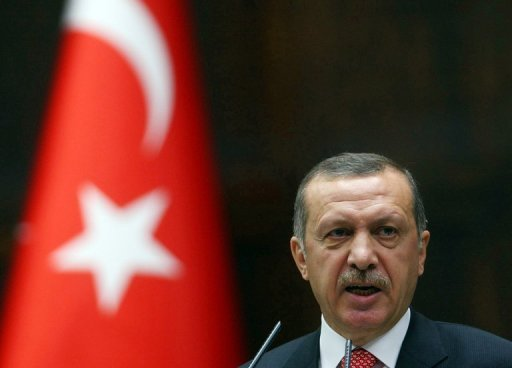 Turkish Prime Minister Recep Tayyip Erdogan addresses the lawmakers of his Justice and Development Party at the parliament in Ankara on June 26. Erdogan leaves for Russia next Wednesday to discuss the developments in Syria with Russian President Vladimir Putin, his office announced Thursday