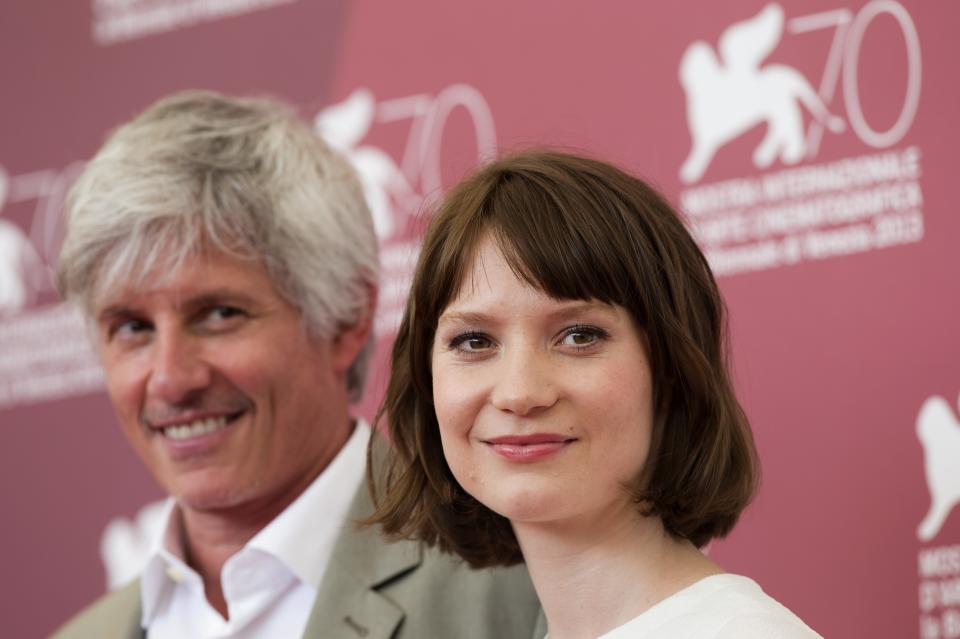 Director John Curran, left, and actress Mia Wasikowska pose for photographers during the 70th edition of the Venice Film Festival held from Aug. 28 through Sept. 7, in Venice, Italy, Thursday, Aug. 29, 2013. (AP Photo/David Azia)