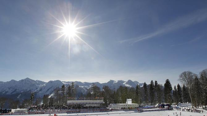 FOR STORY RUSSIA SOCHI YEAR TO GO - In this photo dated Sunday, Feb. 3, 2013, the sun shines over the ski stadium during the FIS Cross-Country World Cup in Sochi, Russia. With just one year till the opening ceremony of the winter Olympic 2014 Sochi Games, the Black Sea resort is still a vast construction site sprawling for nearly 40 kilometers (25 miles) along the coast and 50 kilometers (30 miles) up into the mountains, with no escape from the clang and clatter of the construction works, the drilling, jack-hammering and mixing of cement. (AP Photo/Igor Yakunin)