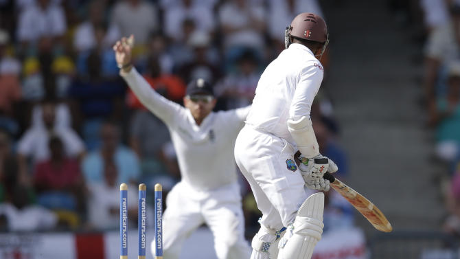 West Indies' Shivnarine Chanderpaul  is bowled out by England's James Anderson during day three of their third Test match at the Kensington Oval in Bridgetown, Barbados, Sunday, May 3, 2015.  (AP Photo/Ricardo Mazalan)