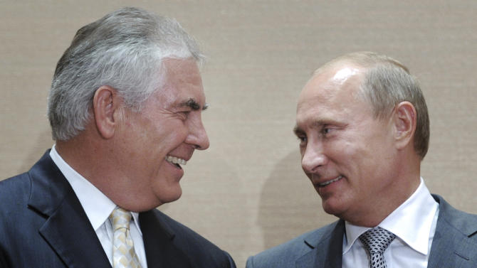 Russian Prime Minister Vladimir Putin, right, and Rex Tillerson, ExxonMobil's chief executive smile during a  signing ceremony in the Black Sea resort of Sochi, Russia, Tuesday, Aug. 30, 2011. Russia's state-owned Rosneft teamed up with U.S. company ExxonMobil on Tuesday to develop huge offshore oil fields in the Russian Arctic in return for access to resources in the Gulf of Mexico. (AP photo/RIA Novosti, Alexei Druzhinin, pool)