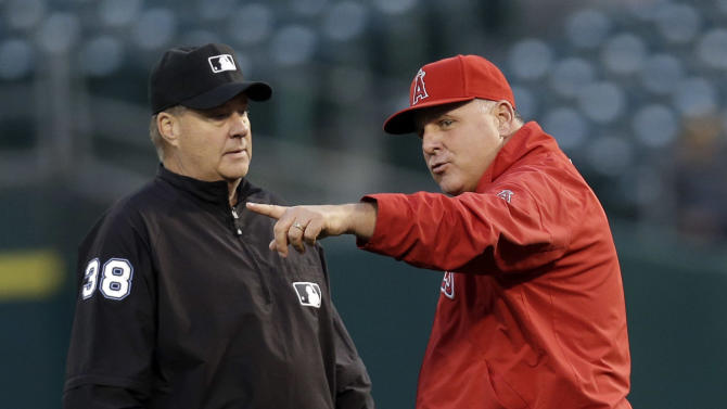 Los Angeles Angels manager Mike Scioscia argues a call by second base umpire Gary Cederstrom during the third inning of a baseball game against the Oakland Athletics on Monday, April 29, 2013 in Oakland. Calif. (AP Photo/Marcio Jose Sanchez)