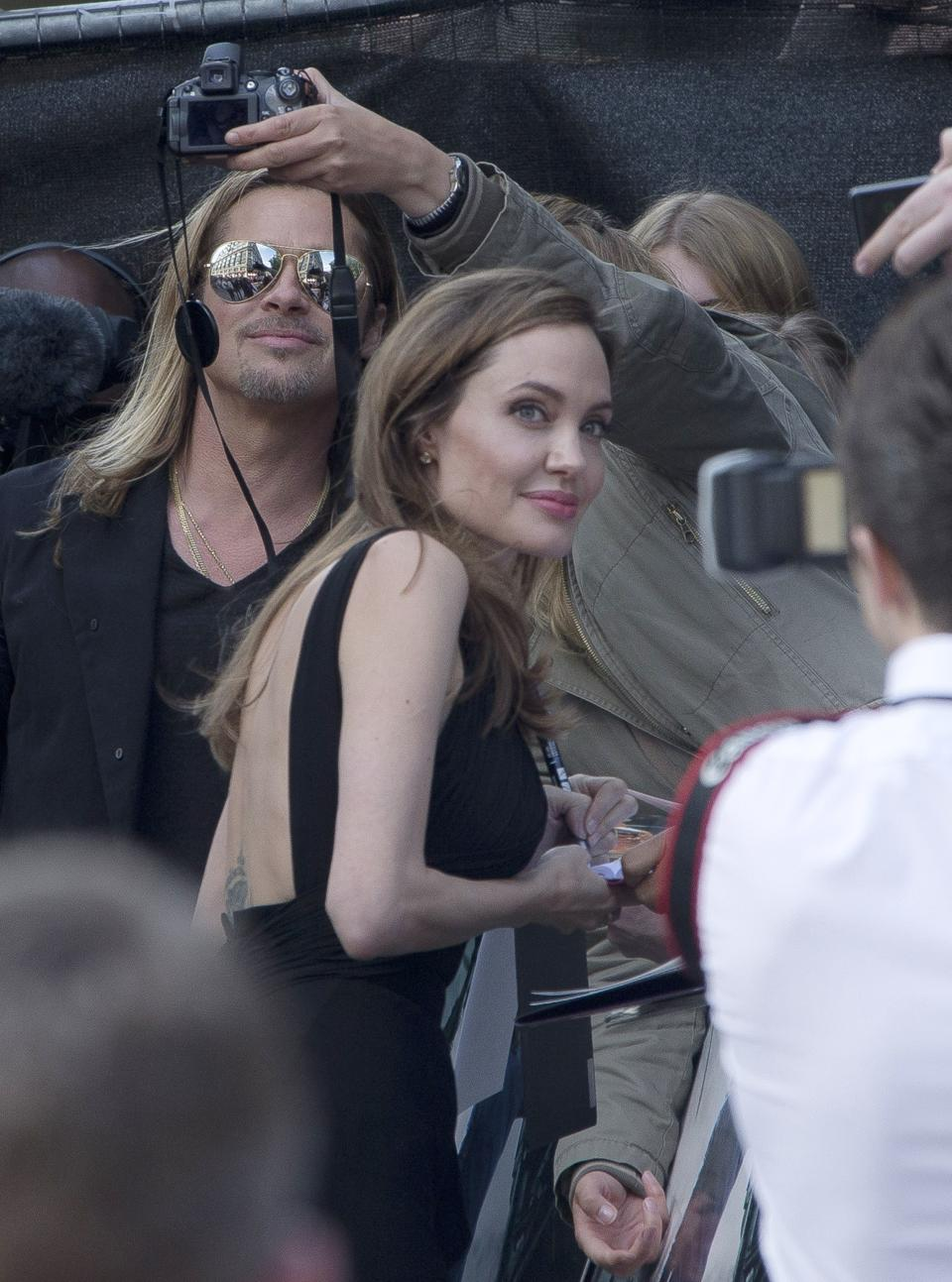 Brad Pitt and Angelina Jolie pose with fans as they arrive for the World Premiere of World War Z  at a central London cinema, Sunday, June 2, 2013. (Photo by Joel Ryan/Invision/AP)