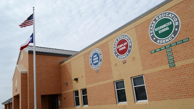 This Feb. 22, 2013 photo provided by the Killeen Independent School District shows the exterior of Meadows Elementary School in Fort Hood, Texas. Meadows is one of nine public schools on Fort Hood operated by Killeen Independent School District, which stands to lose at least $2.6 million before the end of the year if across-the-board federal spending cuts take effect. (AP Photo/Killeen Independent School District, Todd Martin)