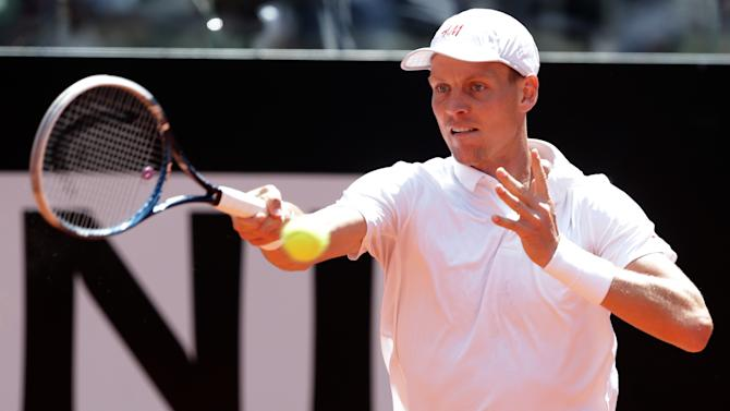 Czech Republic's Tomas Berdych returns the ball to Serbia's Novak Djokovic during their match at the Italian Open tennis tournament in Rome, Friday, May 17, 2013. (AP Photo/Riccardo De Luca)
