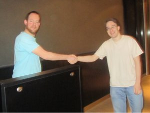 history hack winner shakes hands with Matt Patterson