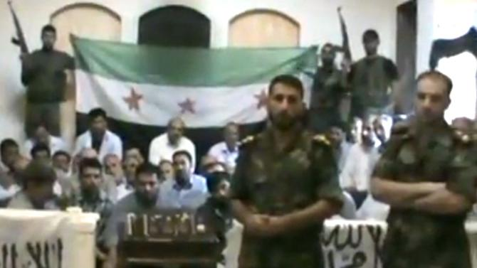 FILE - In this file image made from a video released by the Baraa Brigades and accessed Sunday, Aug. 5, 2012, purports to show Free Syrian Army soldiers guarding a group of Iranians abducted a day earlier and promising more attacks on Iranian targets in Damascus, Syria. (AP Photo/Baraa Brigades via AP video, File) THE ASSOCIATED PRESS IS UNABLE TO INDEPENDENTLY VERIFY THE AUTHENTICITY, CONTENT, LOCATION OR DATE OF THIS HANDOUT PHOTO