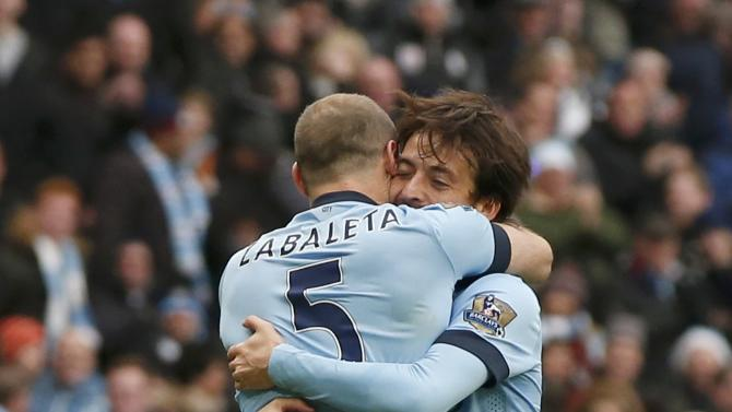 Manchester City's David Silva celebrates with team-mate Pablo Zabaleta after scoring a goal against Crystal Palace during their English Premier League soccer match at the Etihad Stadium in Manchester