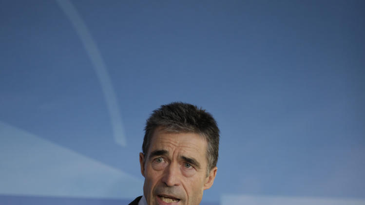 NATO Secretary General Anders Fogh Rasmussen speaks during a media conference prior to a meeting of NATO foreign ministers at NATO headquarters in Brussels on Tuesday, Dec. 4, 2012. NATO foreign ministers are expected to approve Turkey's request for Patriot anti-missile systems to bolster its defense against possible strikes from neighboring Syria. (AP Photo/Virginia Mayo)