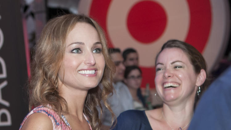 IMAGE DISTRIBUTED FOR TARGET - Celebrity chef Giada De Laurentiis, left, mingles with guests at A Red Hot Night: Presented by Target at the South Beach Wine & Food Festival on Saturday, Feb. 23, 2013 in Miami Beach, Florida. (Mitchell Zachs/AP Images for Target)