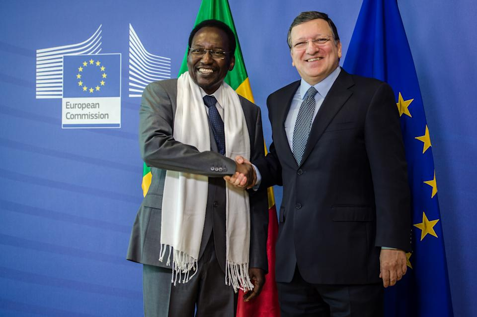 European Commission President Jose Manuel Barroso, right, welcomes Mali's President Dioncounda Traore upon his arrival at the European Commission headquarters in Brussels on Tuesday May 14, 2013. (AP Photo/Geert Vanden Wijngaert)