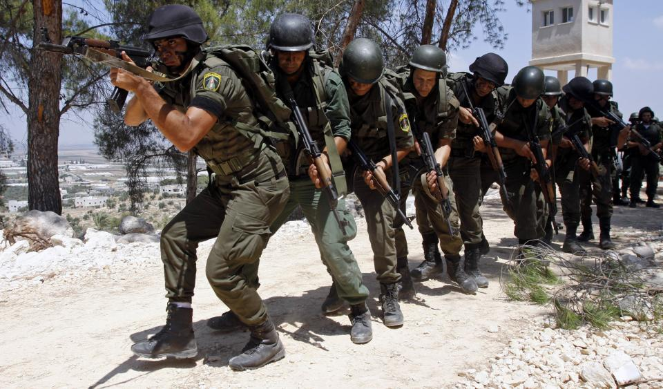 Palestinian security officers hold their weapons as they participate in a training session in the West Bank city of Jenin, Tuesday, Aug. 9, 2011. (AP Photo/Mohammed Ballas)