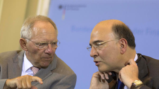 German Finance Minister Wolfgang Schaeuble, left, and his new counterpart from France Pierre Moscovici brief the media after a meeting at the Finance Ministry in Berlin, Monday, May 21, 2012. (AP Photo/Markus Schreiber)