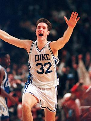 FILE - In this March 28, 1992 file photo, Duke's Christian Laettner runs down the court after making the last second, game-winning shot to defeat Kentucky 104-103 in overtime in the East Regional Final NCAA college basketball game in Philadelphia. Twenty years later, through an up-and-down career NBA career and an even more turbulent venture into real estate, The Shot still follows Laettner. (AP Photo/Amy Sancetta, File)