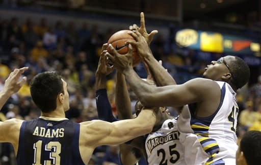 Blue leads No. 18 Marquette past No. 16 Pitt