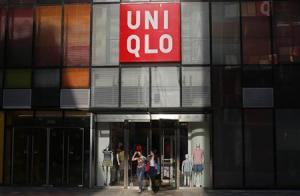 Customers walk out of a UNIQLO store at Taikoo Li Sanlitun shopping centre in Beijing