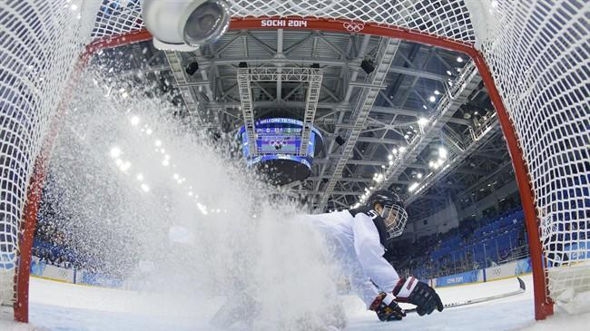 Kanae Aoki of Japan slides to a stop after chasing the goal shot by Franziska Busch of Germany during the closing seconds of the women's ice hockey game at the 2014 Winter Olympics, Thursday, Feb. 13, 2014, in Sochi, Russia. Germany defeated Japan 4-0. (AP Photo/Brian Snyder, Pool)