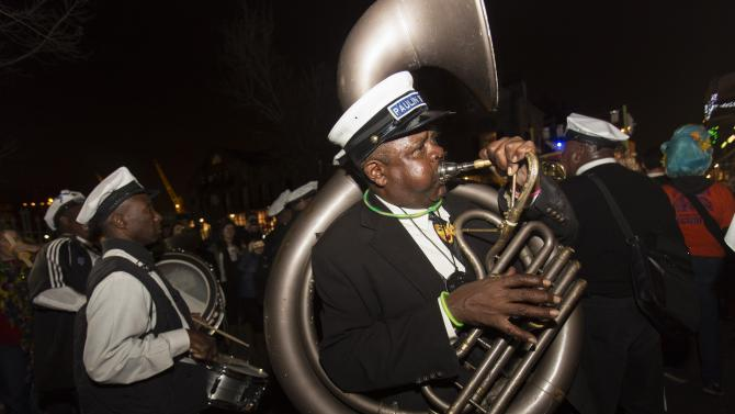 A member of a brass band plays in the Krewe du Vieux 2015 parade, the first parade of the Mardi Gras festivities, through the French Quarter in New Orleans