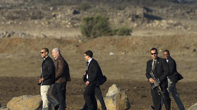 FILE- In this Nov. 14, 2012, file photo, Israeli Prime Minister Benjamin Netanyahu, second left, is surrounded by bodyguards as he walks towards a military helicopter following a visit to the Golan Heights. After seven years in power, Natanyahu has pulled the trigger, unleashing a massive offensive against Gaza rocket-launchers. The public and even his political opponents have all lined up behind him and barring a fiasco involving heavy Israeli casualties, Netanyahu should coast to victory in the upcoming Israeli elections. (AP Photo/Hamad Almakt, File)