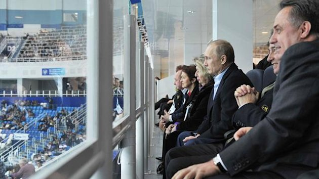 Russian President Vladimir Putin (C) watches the ISU Grand Prix of Figure Skating Final in Sochi (Reuters)